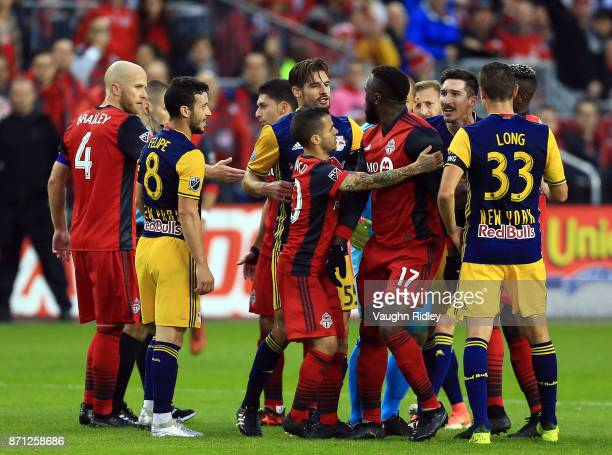 Jozy Altidore of Toronto FC argues with Damien Perrinelle and Sacha Kljestan of New York Red Bulls during the first half of the MLS Eastern...