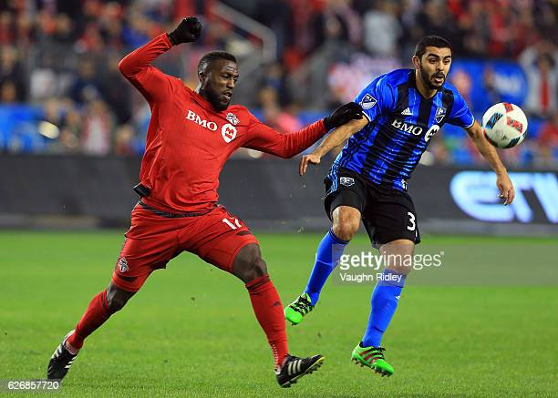 Jozy Altidore of Toronto FC battles for the ball with Hernn Bernardello of Montreal Impact during the first half of the MLS Eastern Conference Final...
