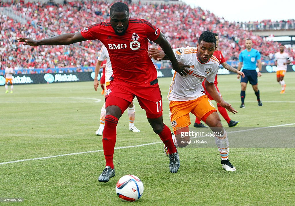 Jozy Altidore #17 of Toronto FC battles for the ball with Luis Garrido #8 of the Houston Dynamo during an MLS soccer game at BMO Field on May 10, 2015 in Toronto, Ontario, Canada.