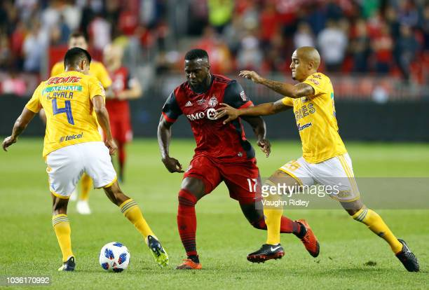 Jozy Altidore of Toronto FC battles for the ball with Luis Rodríguez and Hugo Ayala of Tigres UANL during the first half of the 2018 Campeones Cup...