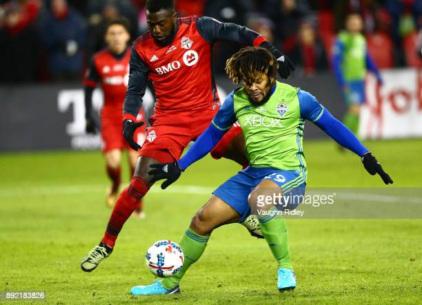 Jozy Altidore of Toronto FC battles for the ball with Roman Torres of the Seattle Sounders during the second half of the 2017 MLS Cup Final at BMO...