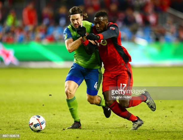 Jozy Altidore of Toronto FC battles with Gustav Svensson of the Seattle Sounders for the ball during the first half of the 2017 MLS Cup Final at BMO...
