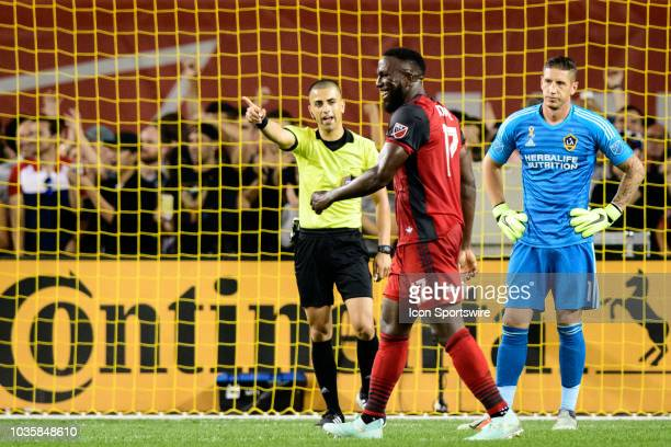 Jozy Altidore of Toronto FC celebrates a goal as David Bingham of LA Galaxy reacts during the first half of the MLS regular season match between...