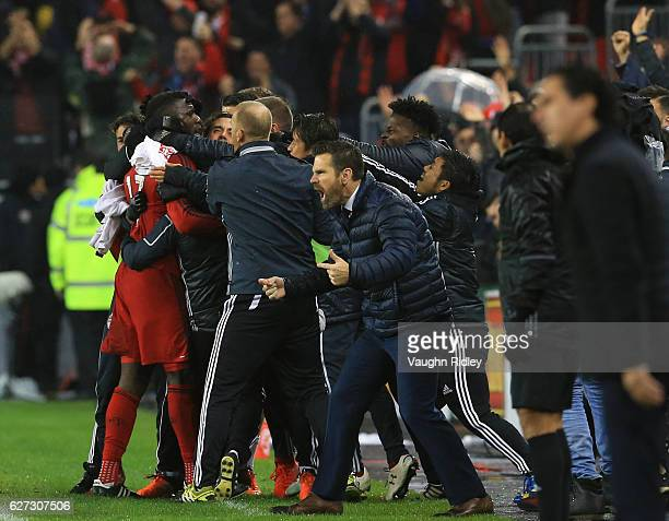 Jozy Altidore of Toronto FC celebrates a goal with teammates as Head Coach Greg Vanney cheers during the first half of the MLS Eastern Conference...