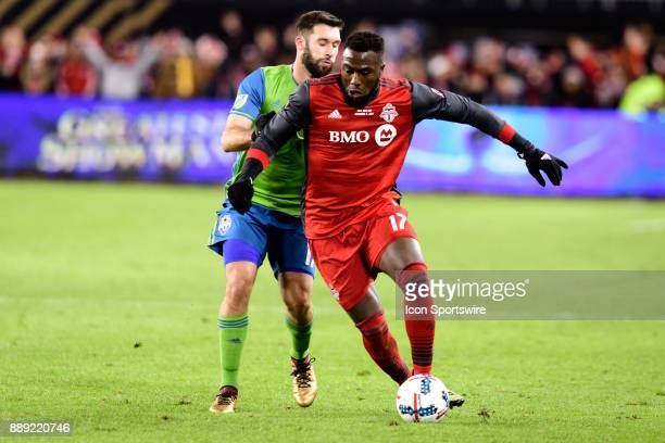 Jozy Altidore of Toronto FC dribbles past Will Bruin of Seattle Sounders FC during the second half of the 2017 MLS Cup Final between Toronto FC and...
