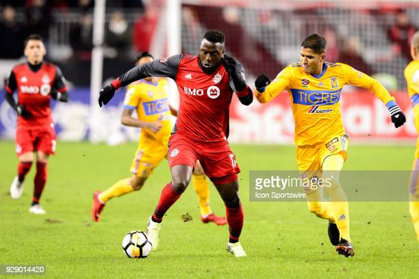 Jozy Altidore of Toronto FC dribbles the ball away from Larry Vásquez of Tigres UANL during the first half of the CONCACAF Champions League...