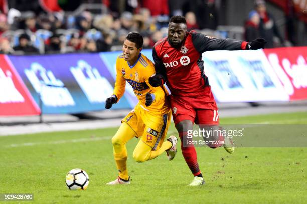 Jozy Altidore of Toronto FC fouls Hugo Ayala of Tigres UANL during the CONCACAF Champions League Quarterfinal match between Toronto FC and Tigres...
