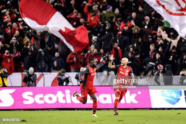 Jozy Altidore of Toronto FC gets a high five from Michael Bradley of Toronto FC after scoring a goal during the second half of the CONCACAF Champions...