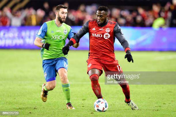 Jozy Altidore of Toronto FC goes against Will Bruin of Seattle Sounders FC during the second half of the 2017 MLS Cup Final between Toronto FC and...