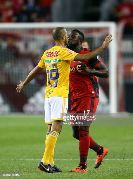 Jozy Altidore of Toronto FC has words with Guido Pizarro during the first half of the 2018 Campeones Cup Final at BMO Field on September 19 2018 in...
