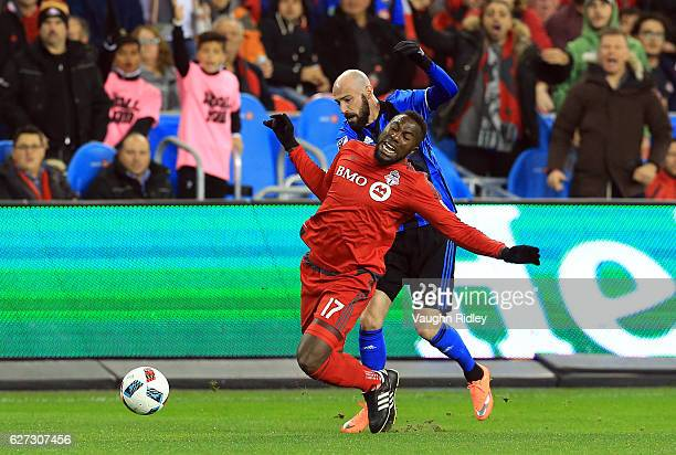 Jozy Altidore of Toronto FC is fouled by Laurent Ciman of Montreal Impact during the first half of the MLS Eastern Conference Final Leg 2 game at BMO...