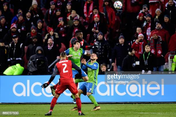 Jozy Altidore of Toronto FC jumps for a header against Nicolas Lodeiro of Seattle Sounders FC during the 2017 MLS Cup Final between Toronto FC and...