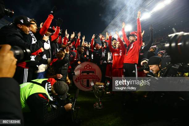 Jozy Altidore of Toronto FC plays a drum with teammates after winning the 2017 MLS Cup Final against the Seattle Sounders at BMO Field on December 9...