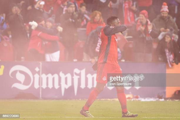 Jozy Altidore of Toronto FC reacts as fans behind him celebrate the opening goal during the second half of the 2017 MLS Cup Final between Toronto FC...