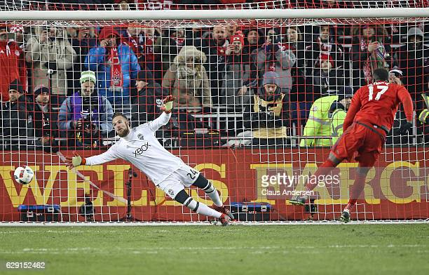 Jozy Altidore of Toronto FC scores against Stefan Frei of the Seattle Sounders during the penalty kick phase during the 2016 MLS Cup at BMO Field on...