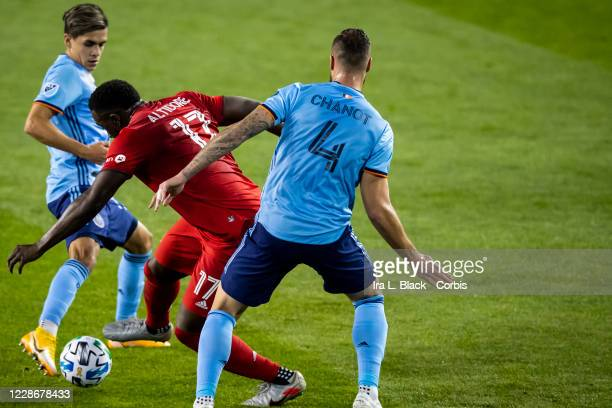 Jozy Altidore of Toronto FC tries to get past Maxime Chanot of New York City and Jesus Medina of New York City during the first half of the Major...