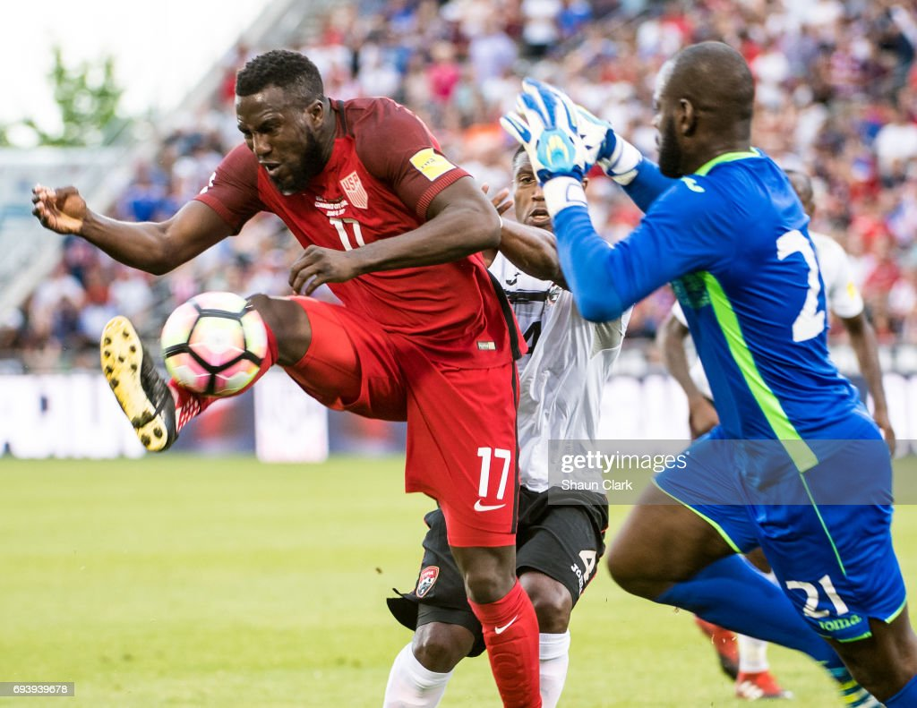 Jozy Altidore #17 of United States tries to get the ball on goal as Jan-Michel Williams #21 of Trinidad & Tobago defends during the World Cup Qualifier match between the United States and Trinidad & Tobago at Dick's Sporting Goods Park on June 8, 2017 in Commerce City, Colorado. The United States won the match 2-0