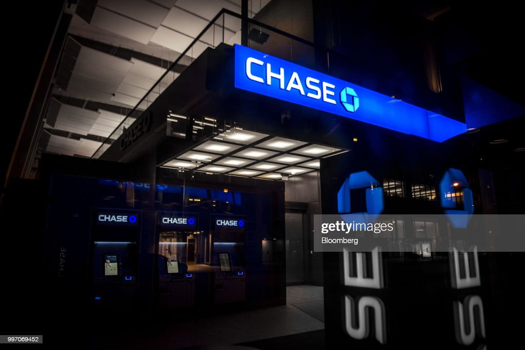 JPMorgan Chase & Co. signage is illuminated at night at a bank branch in Chicago, Illinois, U.S., on Tuesday, July 10, 2017. JPMorgan Chase & Co. is scheduled to release earnings figures on July 13. Photographer: Christopher Dilts/Bloomberg via Getty Images