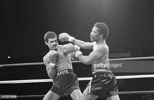 Jr Welterweight champion boxer Aaron Pryor strikes a blow on Nicaraguan challenger Alexis Arguello during the 1982 'Battle of the Champions' fight at...