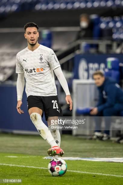JRamy Bensebaini of Borussia Moenchengladbach in action during the Bundesliga match between FC Schalke 04 and Borussia Moenchengladbach at...