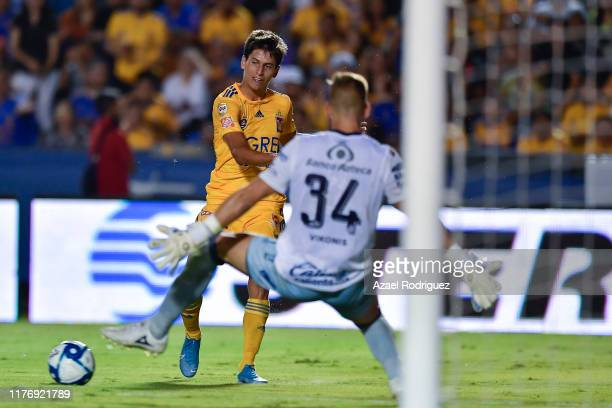 Jürgen Damm of Tigres tries to score over Nicolás Vikonis of Puebla during the 11th round match between Tigres UANL and Puebla as part of the Torneo...