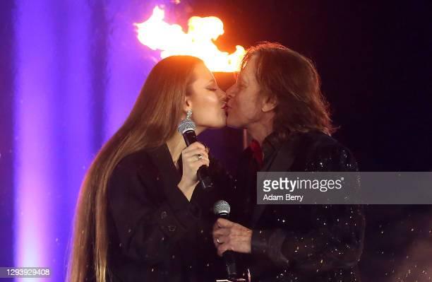 "Jürgen Drews performs with his daughter Joelina Drews during the ""Willkommen 2021"" performance behind the Brandenburg Gate on December 31, 2020 in..."