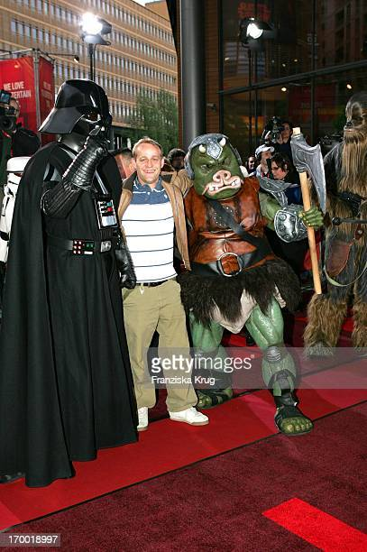 Jürgen Vogel In With The Star Wars figures Dart Vader a Gomerraner And Chewbacca In The Germany premiere of 'Star Wars Episode Iii Revenge of the...
