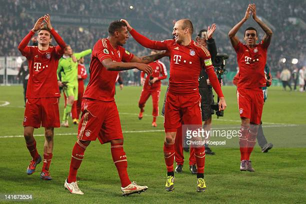 Jérome Boateng and Arjen Robben of Bayern celebrate the 4-2 victory after penalty shoot-out after the DFB Cup semi final match between Borussia...
