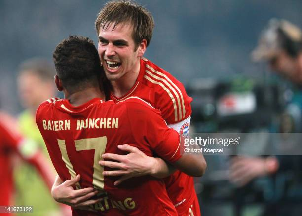 Jérome Boateng and Philipp Lahm of Bayern celebrate the 4-2 victory after penalty shoot-out after the DFB Cup semi final match between Borussia...