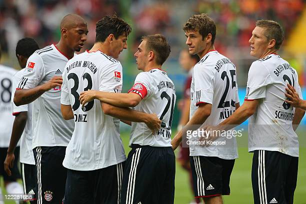 Jérome Boateng Mario Gomez Philipp Lahm Thomas Mueller and Bastian Schweinsteiger of Bayern celebrate the first goal during the Bundesliga match...