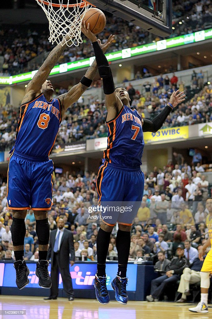 Smith #8 and Carmelo Anthony #7 of the New York Knicks reach for a rebound during the NBA game against the Indiana Pacers at Bankers Life Fieldhouse on April 3, 2012 in Indianapolis, Indiana.