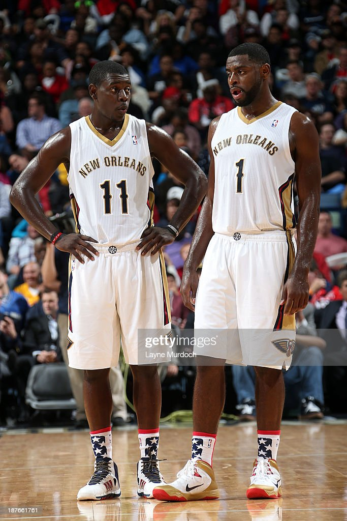 Jrue Holiday #11 and Tyreke Evans #1 of the New Orleans Pelicans talk during he game against the Los Angeles Lakers on November 8, 2013 at the New Orleans Arena in New Orleans, Louisiana.