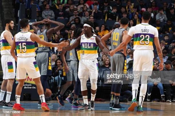 Jrue Holiday Anthony Davis and Frank Jackson of the New Orleans Pelicans highfive during a game against the Memphis Grizzlies on February 9 2019 at...