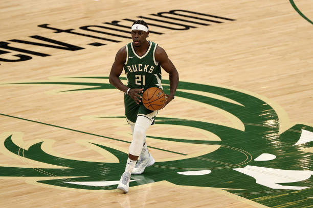 Jrue Holiday of the Milwaukee Bucks handles the ball during a game against the Boston Celtics at Fiserv Forum on March 24, 2021 in Milwaukee,...