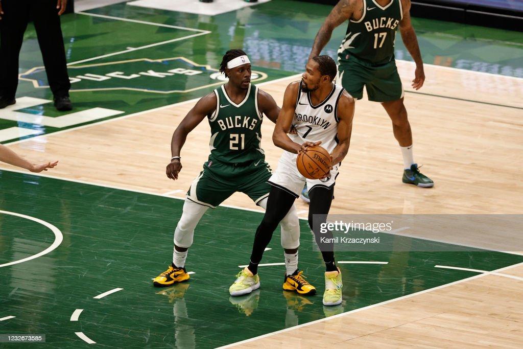 Jrue Holiday of the Milwaukee Bucks plays defense on Kevin ...
