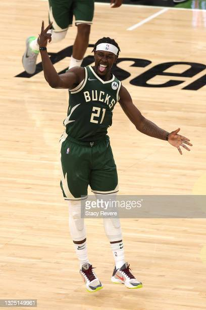 Jrue Holiday of the Milwaukee Bucks reacts to a three point shot against the Atlanta Hawks during the fourth quarter in game one of the Eastern...