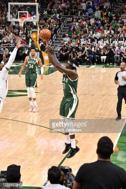 Jrue Holiday of the Milwaukee Bucks shoots a three-pointer against the Phoenix Suns during Game Three of the 2021 NBA Finals on July 11, 2021 at...