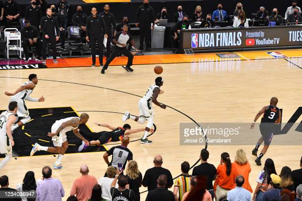 Jrue Holiday of the Milwaukee Bucks steals the ball from Devin Booker of the Phoenix Suns during Game Five of the 2021 NBA Finals on July 17, 2021 at...