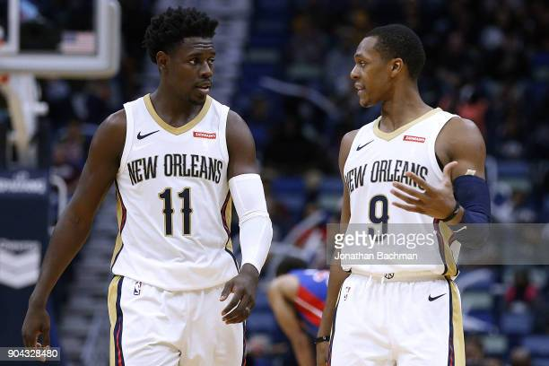 Jrue Holiday of the New Orleans Pelicans and Rajon Rondo talk during the second half against the Detroit Pistons at the Smoothie King Center on...
