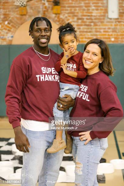 Jrue Holiday of the New Orleans Pelicans attends his third annual Turkey Day with Holiday and distributes Thanksgiving dinners to families on...