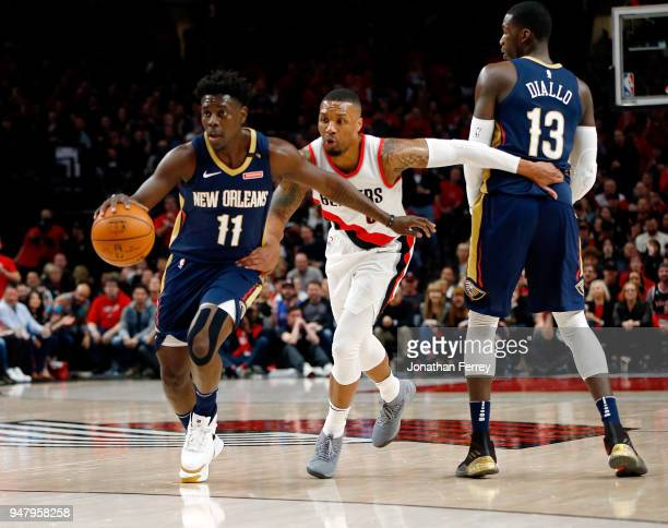 Jrue Holiday of the New Orleans Pelicans battles against Damian Lillard of the Portland Trail Blazers during Game One of the Western Conference...