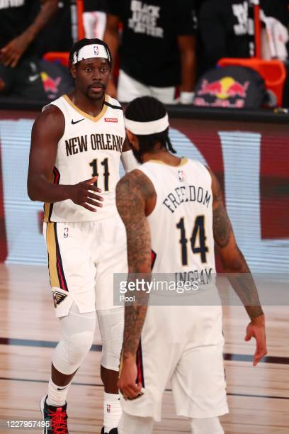 Jrue Holiday of the New Orleans Pelicans celebrates a play with Brandon Ingram during the fourth quarter in an NBA basketball game at Visa Athletic...