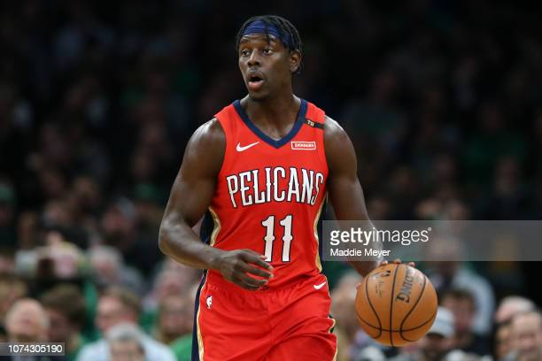 Jrue Holiday of the New Orleans Pelicans dribbles against the Boston Celtics at TD Garden on December 10 2018 in Boston Massachusetts