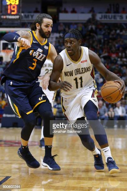 Jrue Holiday of the New Orleans Pelicans drives against Ricky Rubio of the Utah Jazz during the second half at the Smoothie King Center on March 11...