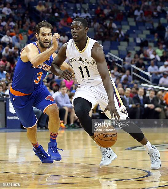 Jrue Holiday of the New Orleans Pelicans drives past Jose Calderon of the New York Knicks during the first half at the Smoothie King Center on March...