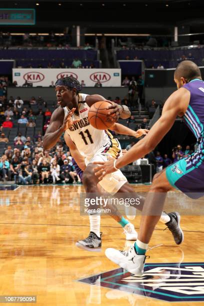 Jrue Holiday of the New Orleans Pelicans drives to the basket against the Charlotte Hornets on December 2 2018 at Spectrum Center in Charlotte North...