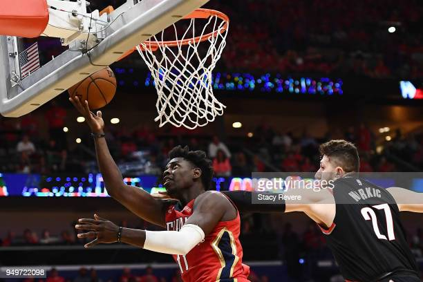 Jrue Holiday of the New Orleans Pelicans drives to the basket against Jusuf Nurkic of the Portland Trail Blazers during the second half of Game Four...