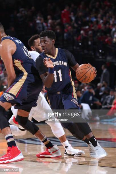 Jrue Holiday of the New Orleans Pelicans drives to the basket during the game against the Portland Trail Blazers on April 12 2017 at the Moda Center...