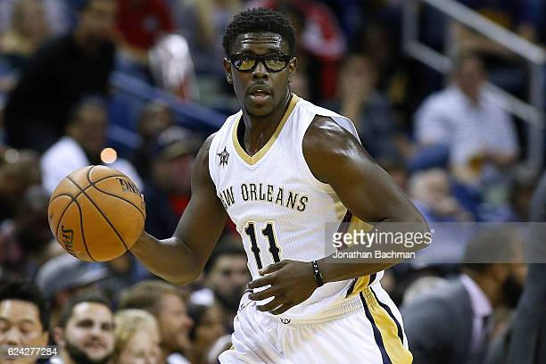 Jrue Holiday of the New Orleans Pelicans drives with the ball during the first half of a game against the Portland Trail Blazers at the Smoothie King...