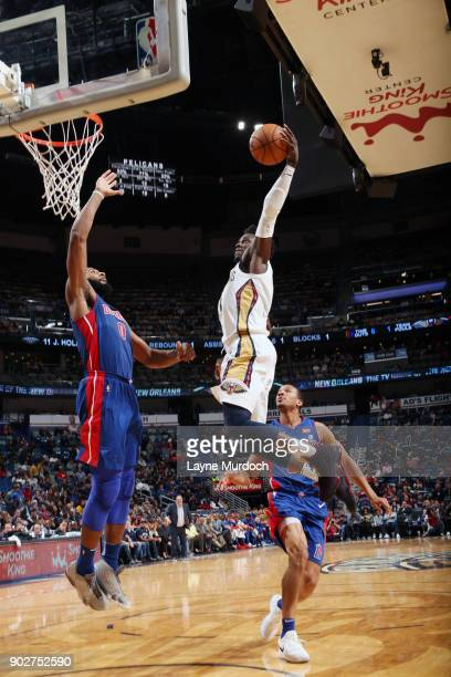 Jrue Holiday of the New Orleans Pelicans dunks against Andre Drummond of the Detroit Pistons on January 8 2018 at Smoothie King Center in New Orleans...